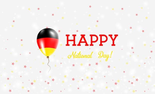 Plakat patriotyczny święto narodowe niemiec. latający balon gumowy w barwach niemieckiej flagi. niemcy święto narodowe tło z balonem, konfetti, gwiazdy, bokeh i błyszczy.