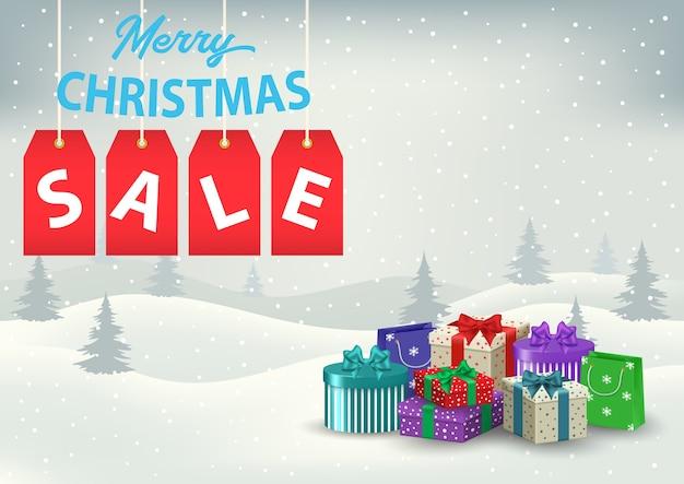 Plakat świątecznej wyprzedaży z kolorowymi prezentami na tle zaśnieżonych wzgórz.