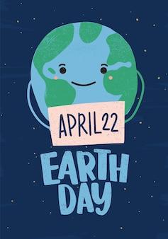 Planeta lub kula ziemska z uśmiechniętą twarz trzyma znak z datą 22 kwietnia.