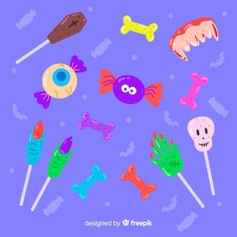 Płaska kolekcja cukierków halloween na niebieskim tle