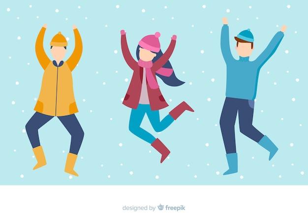 Płaska konstrukcja ilustracja młodych ludzi ubranych w zimowe ubrania skoki