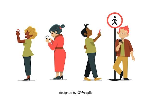Płaska konstrukcja młodych ludzi posiadających smartfony