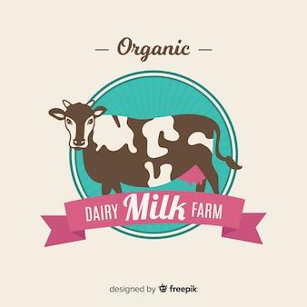 Płaska krowa z logo wstążki mleka ekologicznego