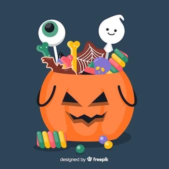 Płaska torba z dyni halloween wypełniona cukierkami