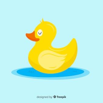 Płaska żółta gumowa kaczka na kałuży