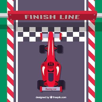 Płaski czerwony samochód wyścigowy f1 przecina linię mety