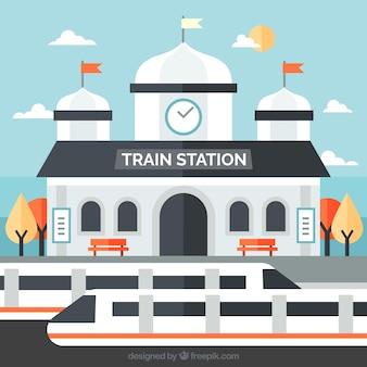 Płaski dworzec kolejowy z nowoczesnymi pociągami