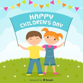 Płaski dzień dziecka z sztandarem i girlandami