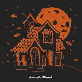 Płaski halloween pomarańczowy i czarny dom