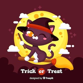 Płaski kot halloween na miotle w nocy