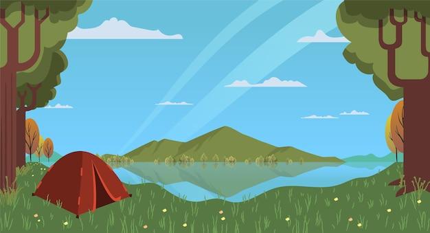 Płaski krajobraz obszaru kempingowego z namiotem