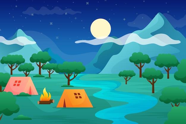 Płaski krajobraz terenu kempingowego z namiotami i rzeką