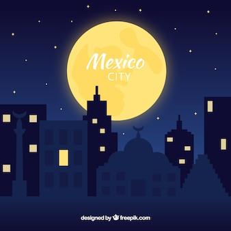 Płaski mexico city przy nocy tłem