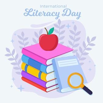Płaski międzynarodowy dzień alfabetyzacji z książkami i jabłkiem