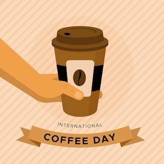 Płaski międzynarodowy dzień kawy z filiżanką na wynos