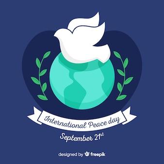 Płaski międzynarodowy dzień pokoju z gołębicą