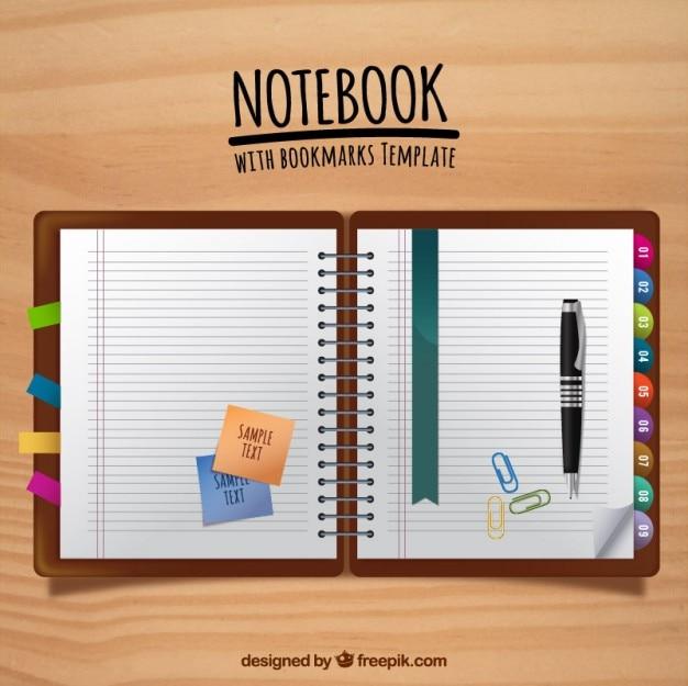 Płaski notatnik z zakładkami i pióra z post-its