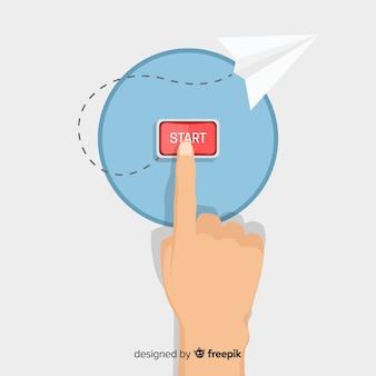 Płaski palec naciskając czerwony przycisk start