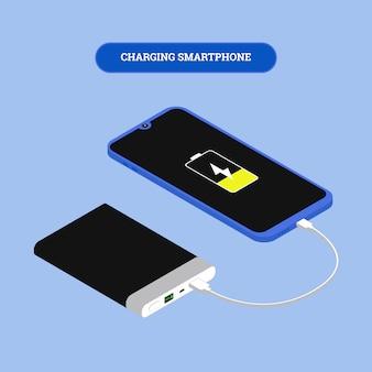 Płaski smartfon izometryczny połączony z bankiem mocy za pomocą kabla usb.