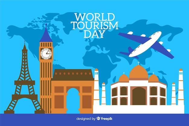 Płaski światowy dzień turystyki z mapy świata w tle