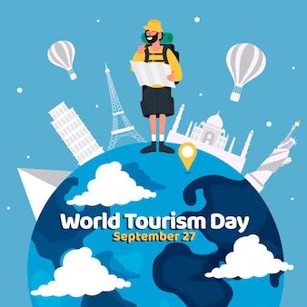 Płaski światowy dzień turystyki z podróżnikiem