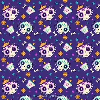 Płaski wzór dia de muertos i uśmiechnięte czaszki