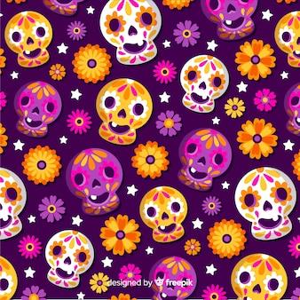 Płaski wzór día de muertos ze szczęśliwymi czaszkami
