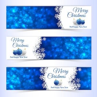 Płaski zestaw poziome banery noworoczne i świąteczne ozdobione kulkami i płatkami śniegu