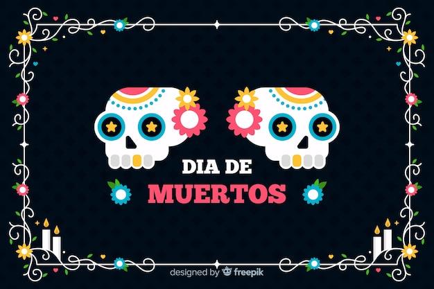 Płaskie czarne tło i czaszki día de muertos