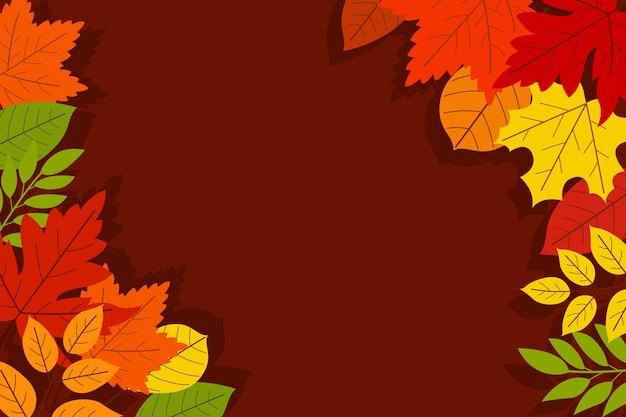 Płaskie jesienne liście w tle