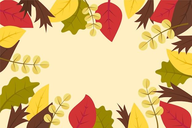 Płaskie jesienne tło z liśćmi