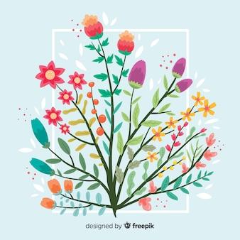 Płaskie kolorowe oddział kwiatowy na niebieskim tle