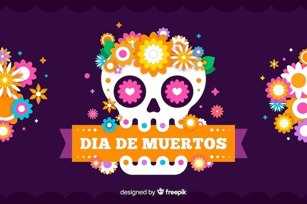 Płaskie tło día de muertos z czaszką i wstążką