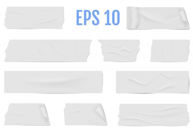 Plastry białej taśmy samoprzylepnej z cieniem i zmarszczkami.