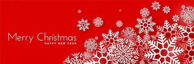 Płatki śniegu bożego narodzenia zimą na czerwonym tle banner