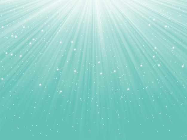 Płatki śniegu i gwiazdy schodzące na ścieżce światła.