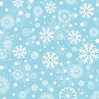 Płatki śniegu na jasnoniebieskim tle