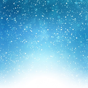 Płatki śniegu na niebieskim tle bokeh