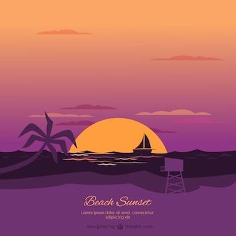 Plaża o zachodzie słońca w tle