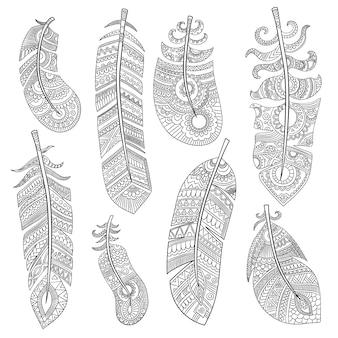 Plemienne pióra. grunge autentyczne tekstury moda indyjskie pióra na białym tle zdjęcia
