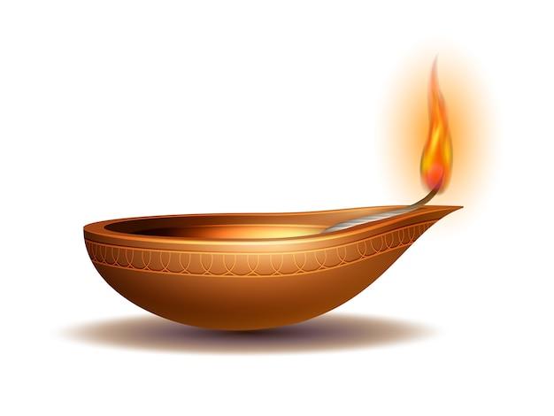 Płonąca diya na happy diwali holiday na białym tle na święto światła w indiach. świąteczne elementy dekoracyjne lampa naftowa deepavali.