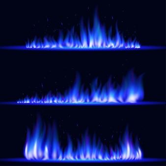 Płonące realistyczne niebieskie płomienie ognia. świecące cząsteczki. efekt świetlny, ognisko.