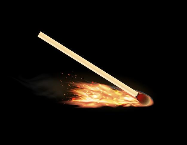 Płonący zapałka na czarnym tle