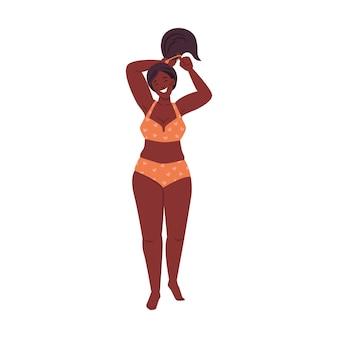 Plus rozmiar mała śliwka afro amerykańska kobieta w bikini ciało pozytywna dama w stroju kąpielowym na białym tle