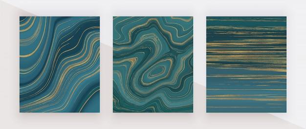 Płynna marmurowa konsystencja w kolorze morskim. niebieski i złoty brokat tuszem malowanie abstrakcyjny wzór.