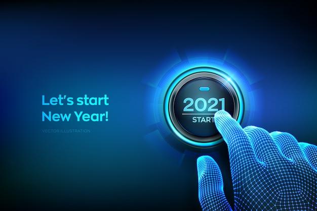 Początek 2021 roku. palec chce nacisnąć przycisk z tekstem 2021 - początek.