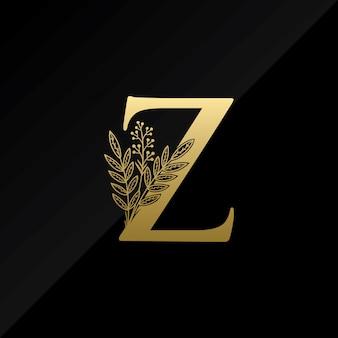 Początkowa litera z logo z prostym kwiatem w kolorze złotym