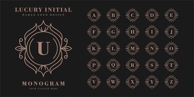 Początkowa plakietka lucury z logo monogramu