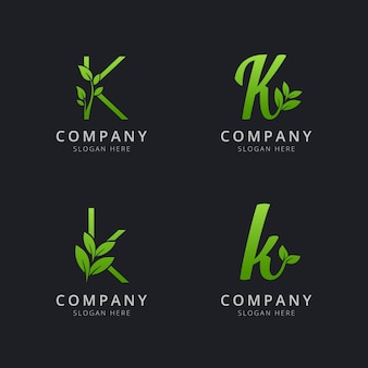 Początkowe logo k z elementami liści w kolorze zielonym