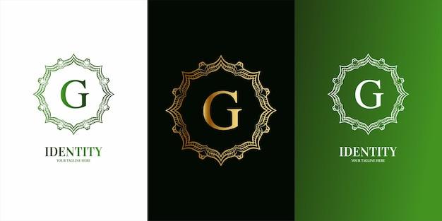 Początkowy alfabet litery g z luksusowym ornamentem kwiatowy szablon logo ramki.